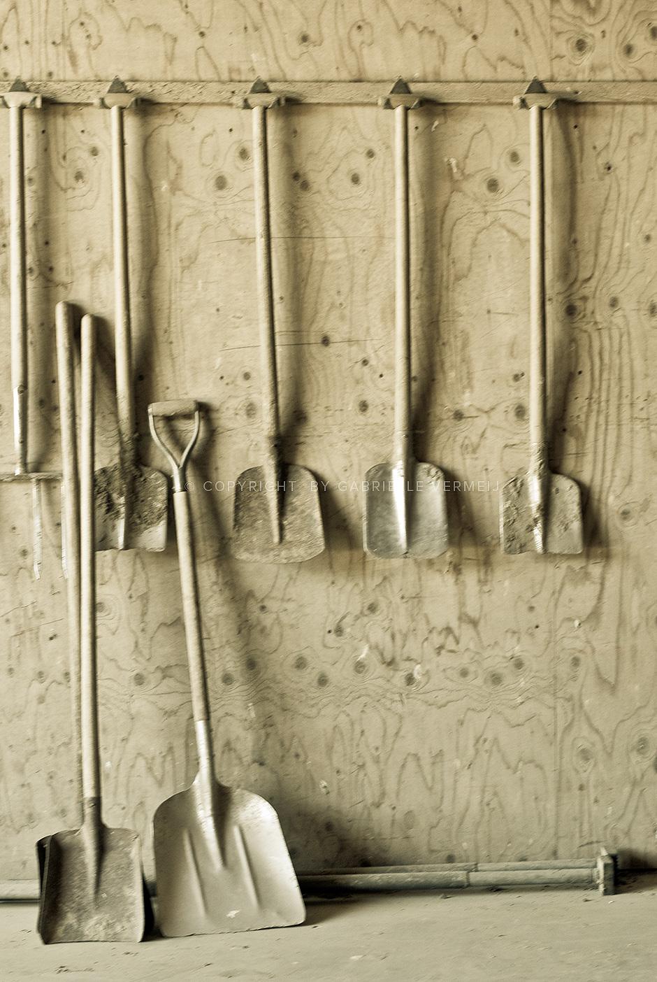 Various shovels in a barn by Gabrielle Vermeij